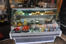 Starting with the food, there's this big cabinet in the far corner, stocked full of goodies.