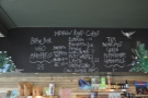 The hot drinks menu, plus artwork, is chalked up above the counter...