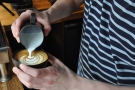 Each blob of milk is added with a distinct pour...