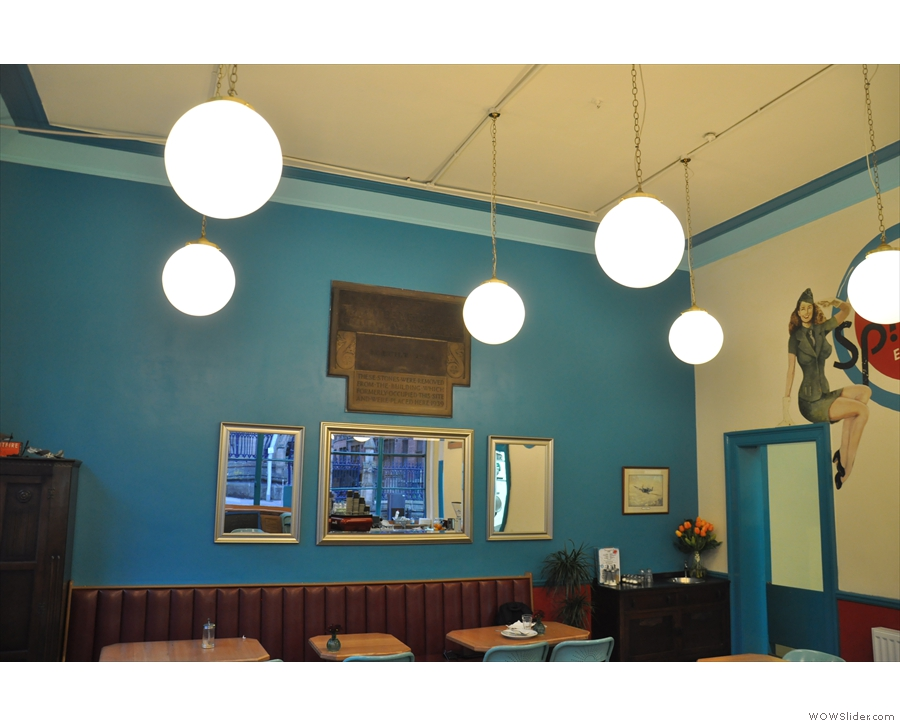 The lighting is provided by these illuminated globes hanging from the ceiling.