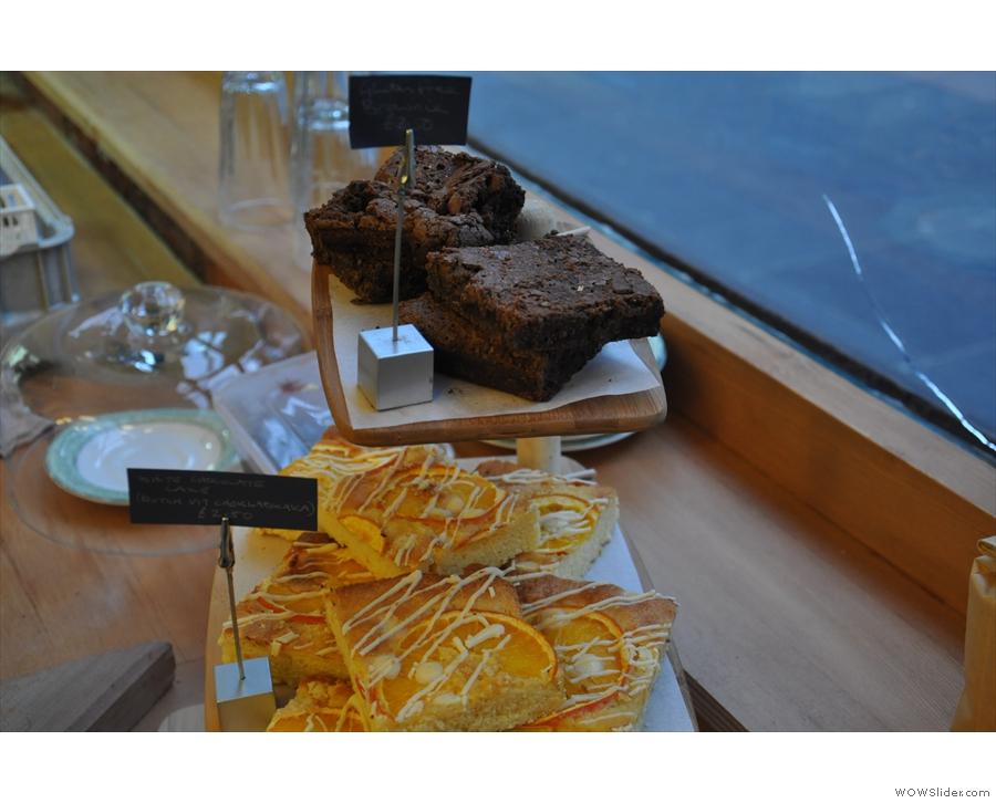 White chocolate cake (bottom) and gluten-free brownies (top).
