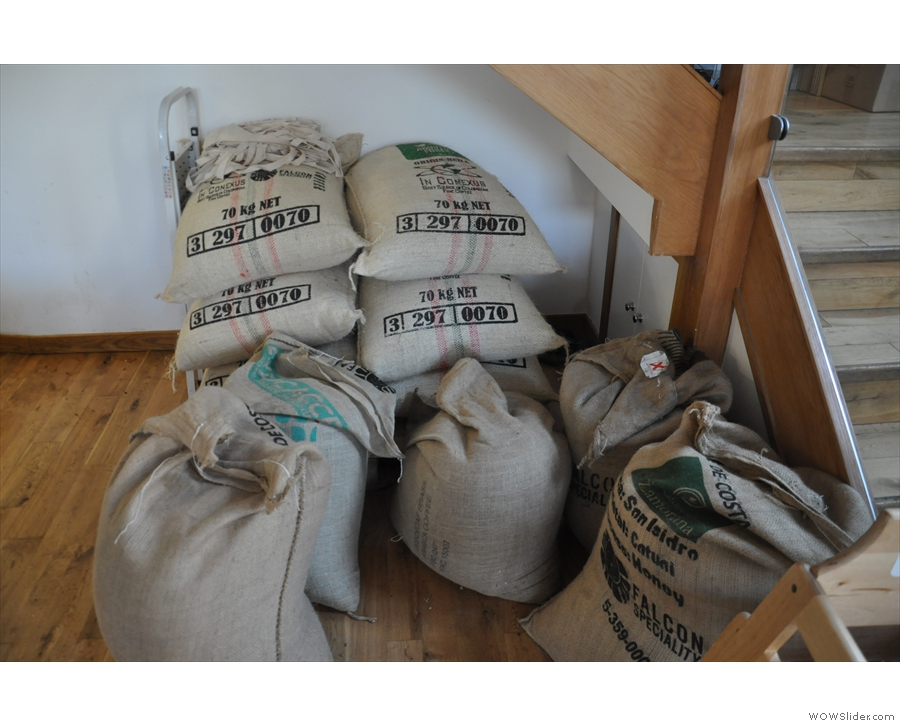 The sacks of green beans are stored at the bottom of the stairs...