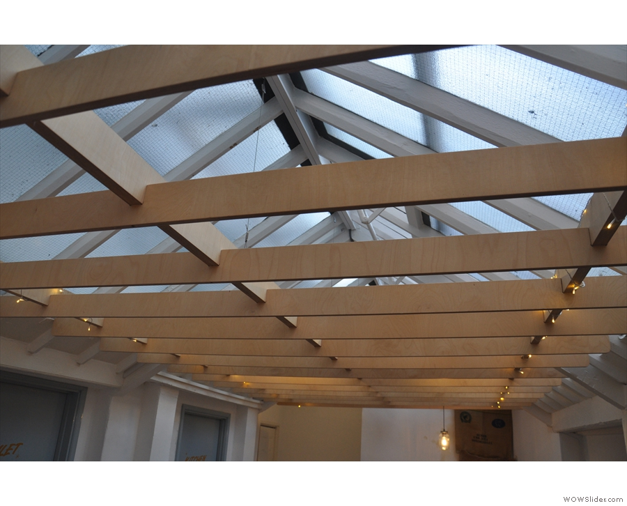 The back room is really bright, thanks to its transparent roof.