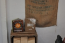 Next to Cherie, one of a number of retail shleves, with bags of coffee for sale.