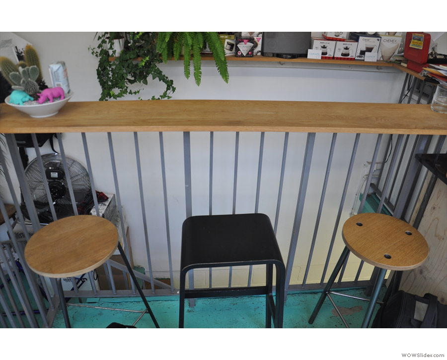 ... and this three-seat bar overlooking the stairs on the other side.