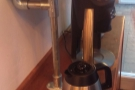 The ground coffee goes into the hopper...
