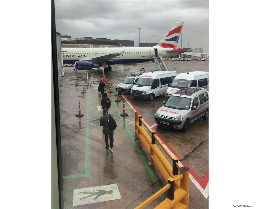 Of course, Manchester had a parting gift. You have to walk (in the rain) to board the plane.