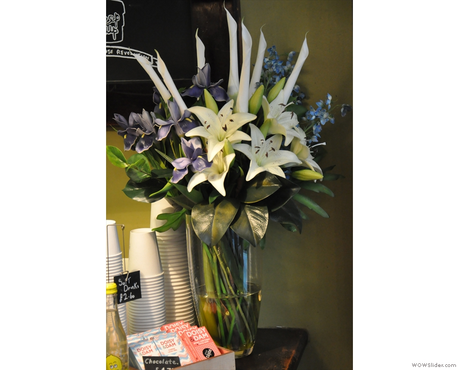 I always find that flowers are a nice touch in a coffee shops.