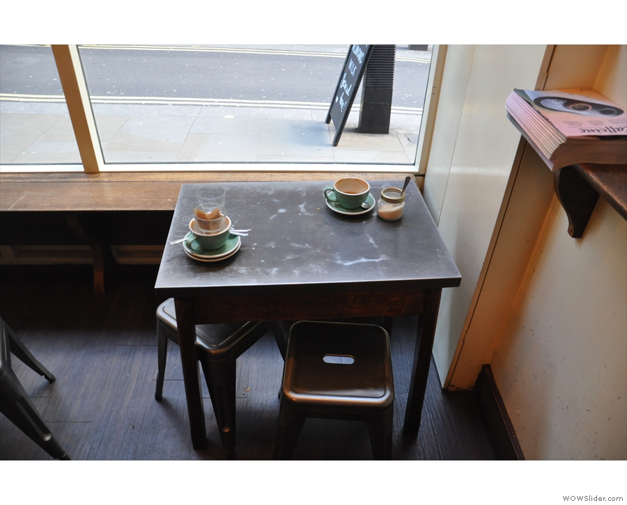 The only other seating is in the window, where two tables line a window-bench.
