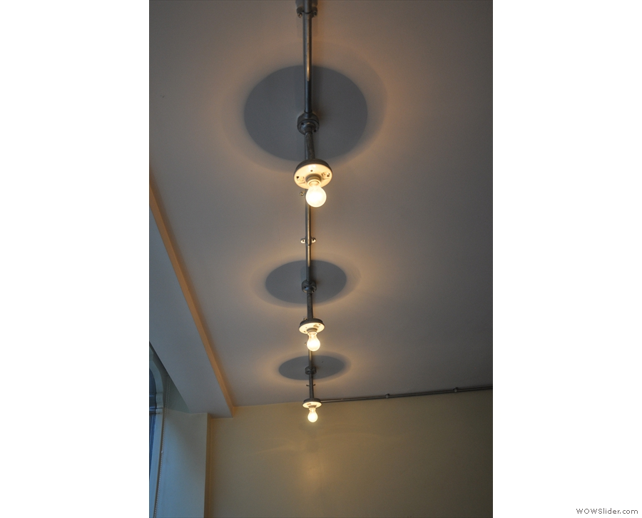 Despite the front being all windows, there are plenty of lights, such as these above the tables.