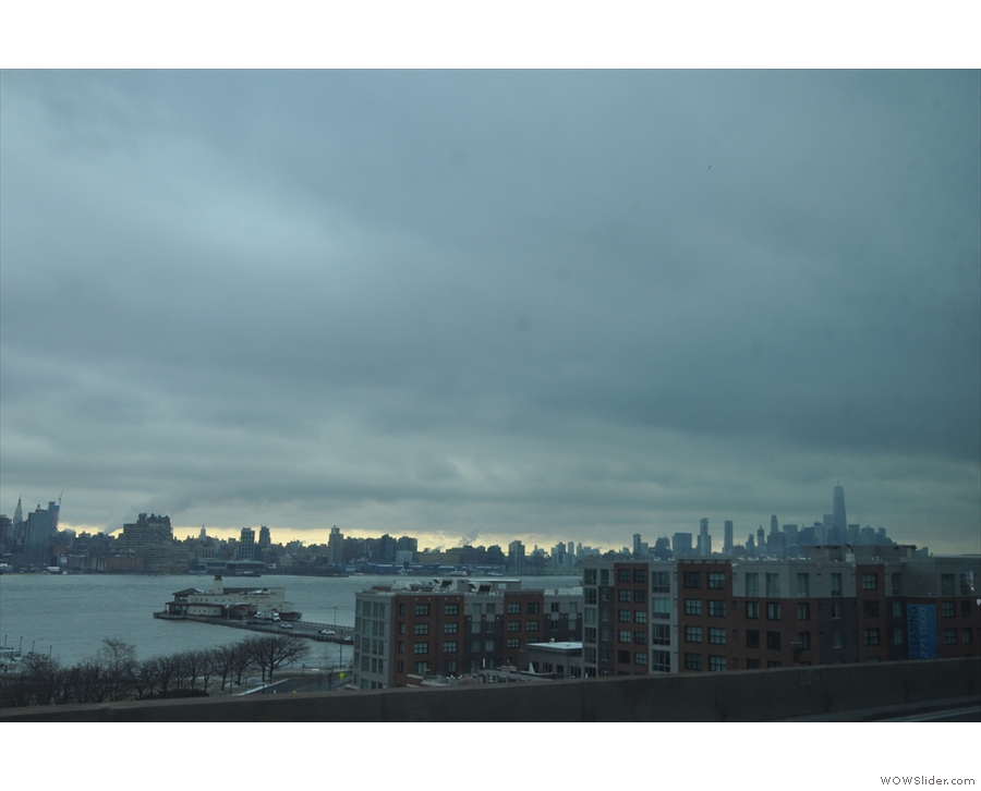 A first glimpse of downtown Manhattan from the bus on the approach to the Lincoln Tunnel.