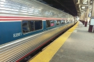 The faamiliar red, white, blue and bare metal of Amtrak. And distinctly single deck!