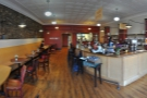 This is the view to the left of the door, showing the island counter & the bulk of the seating.