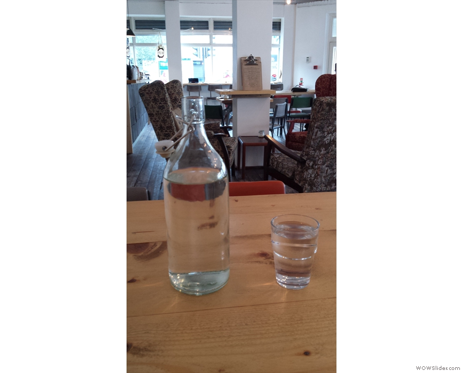 While I was waiting for my coffee, a bottle of water and a glass arrived, unprompted.