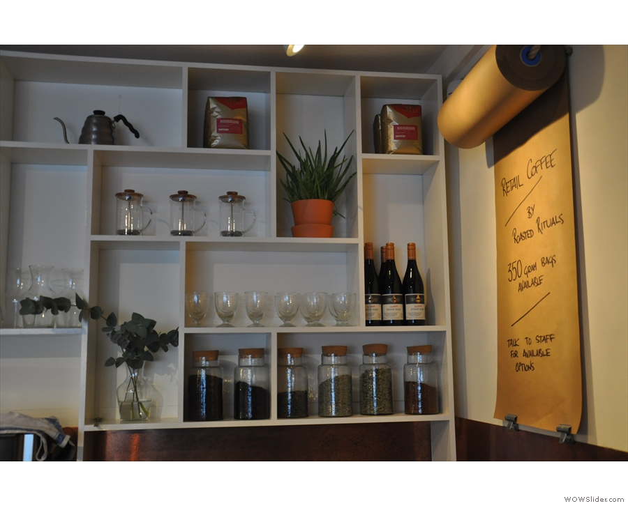There's tea and wine and other goodies on shelves behind the counter...