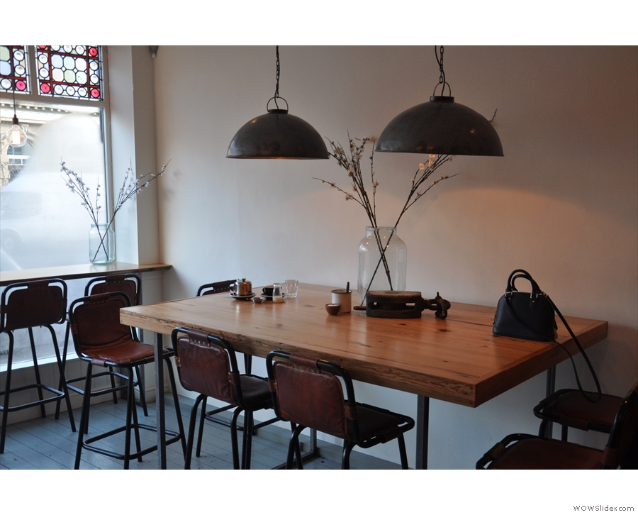 Opposite them is this six-person table against the left-hand wall...