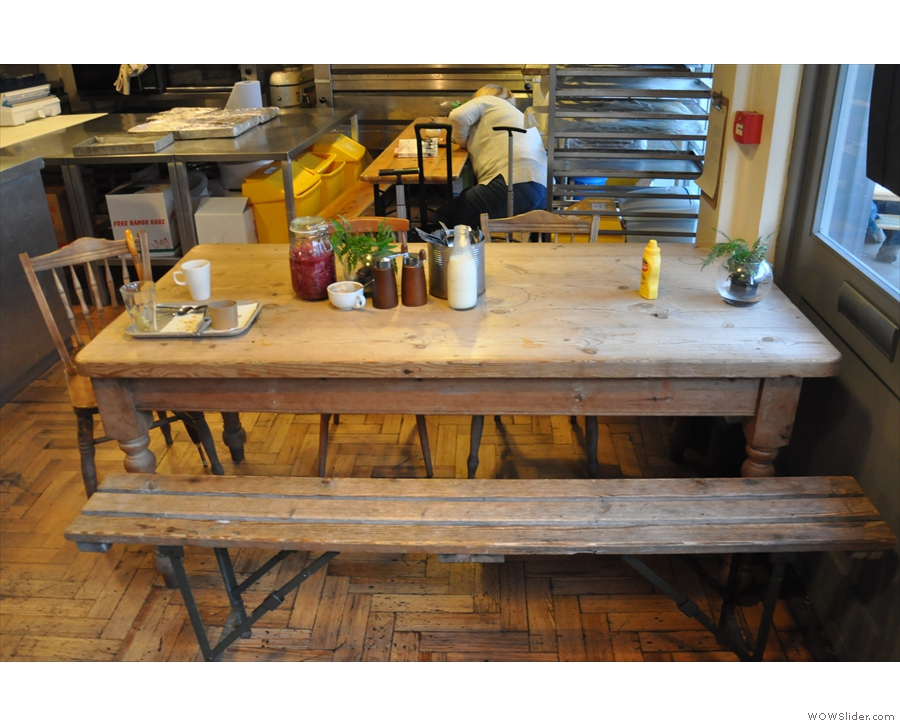 These days, there's quite a bit of seating, including this large, communal table to the right...