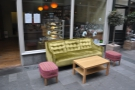 As well as the usual tables, there are two colourful sofas: this, to the right of the door...