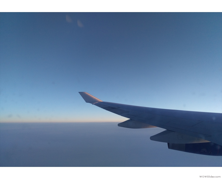 Much of the flight was in darkness, but here's a hint of dawn approaching the Irish coast.