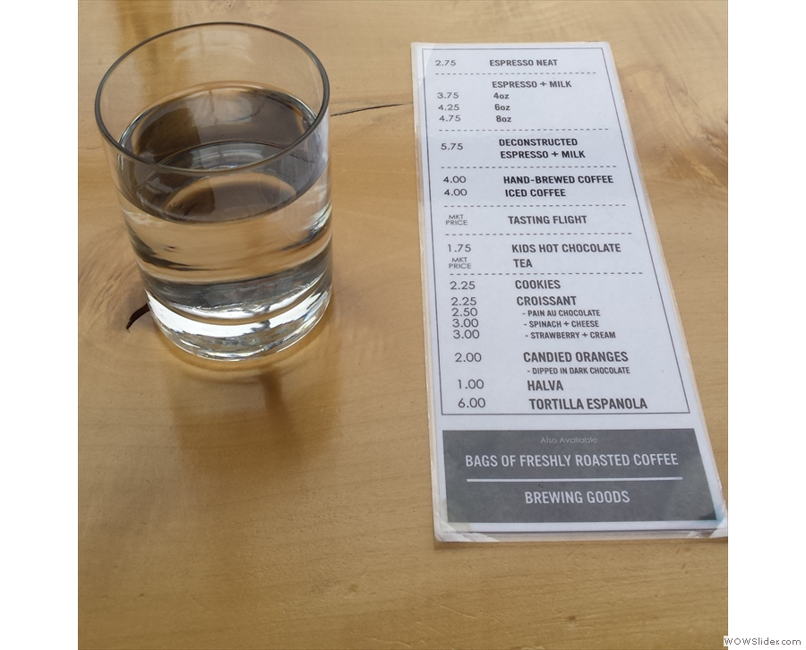 Slate has full table service. Sit down & a menu, plus a glass of water, will be brought to you.