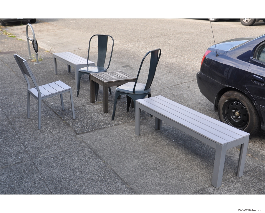 There are also two benches, around a small table which is opposite the door.