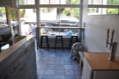 The view from the end of the counter, looking towards the window. Check out the slate floor.