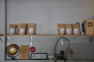 There are more bags of coffee behind the counter...