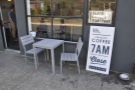 The right hand of the two tables outside. Hang on, what's that sign say?