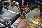 11 seconds in, the espresso's almost done, and only now do we hit 9 bar!