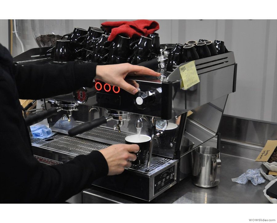 There's also this two-group La Marzocco which gets put to use. Let's warm the cup first...
