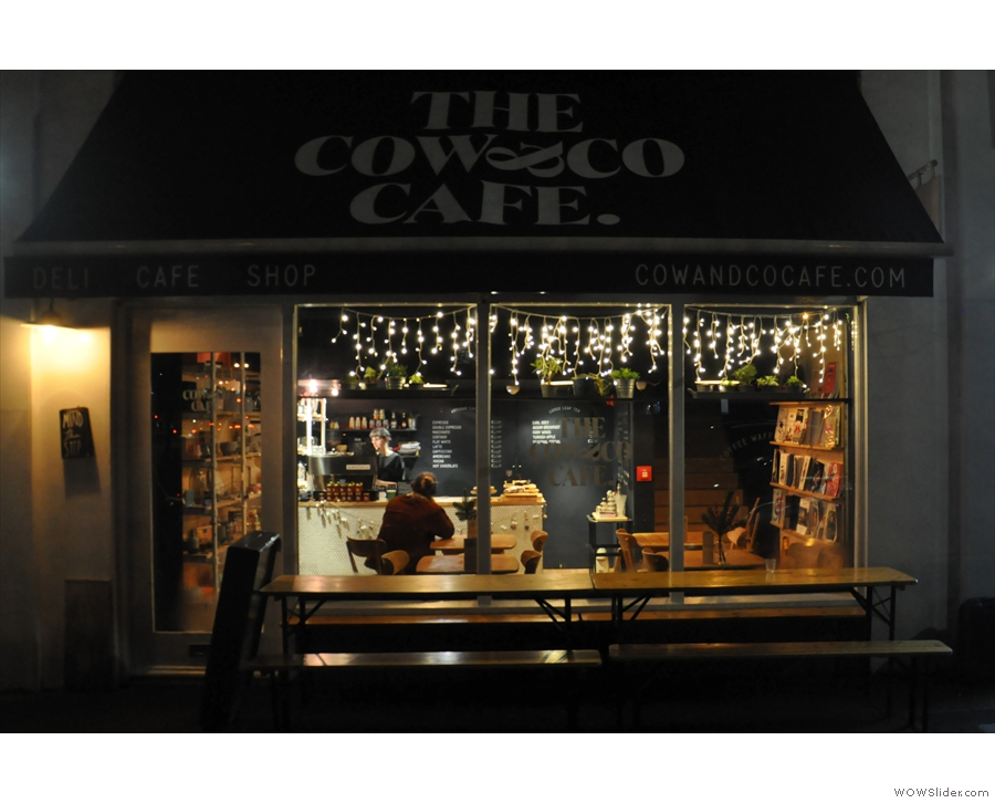 The Cow & Co Cafe on Liverpool's Cleveland Square on a dark, December evening.