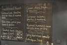... while the surprisingly comprehensive food menu is chalked on the wall to the right.