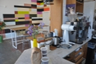 A view of the communal table in the seating area, as seen from the end of the counter...