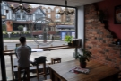 A slightly bettter view of the communal table and of the lights hanging in the window.