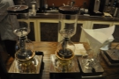 There's a pair of syphons and a chemex...