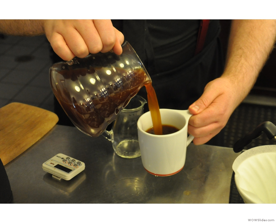 The coffee is then poured from the carafe into a pre-warmed mug...