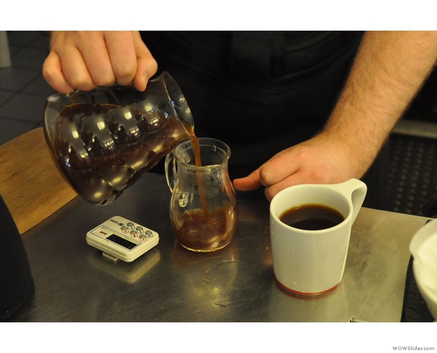 ... and the remainder is poured into a smaller, pre-warmed carafe...