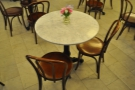 All the tables are marble-topped. I've written many a postcard from here over the years!