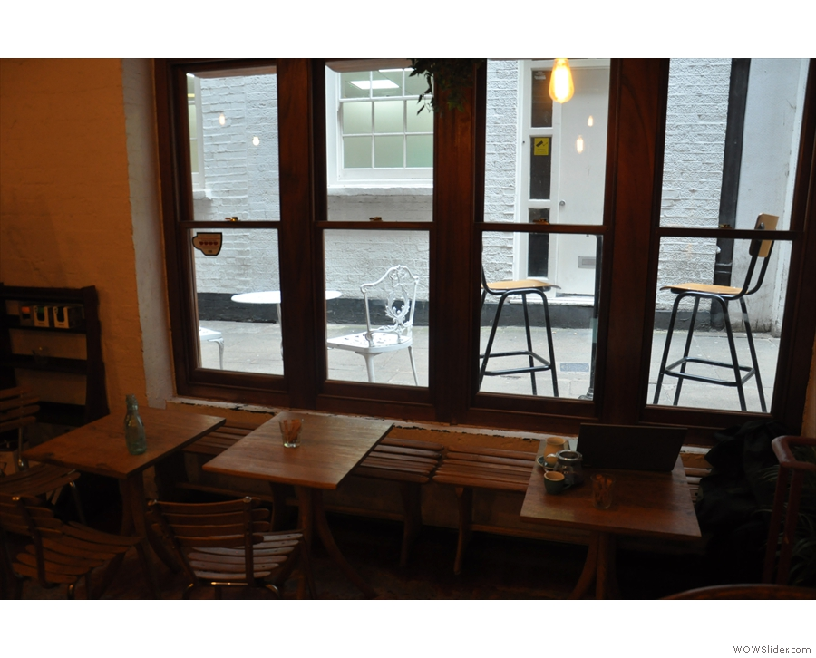 The three tables in the window are ideal for looking at the ankles of anyone sitting outside.