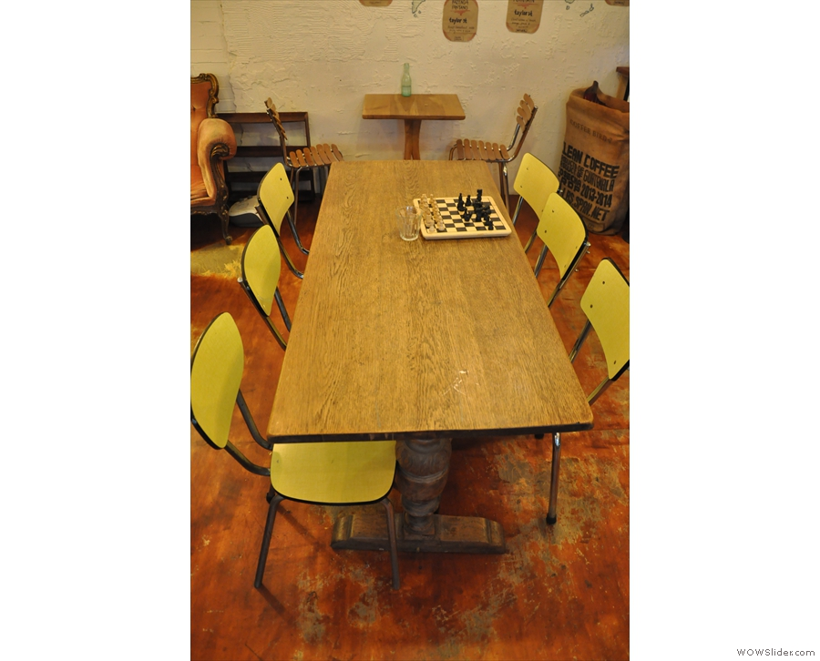 There's a communal table in the centre of the room, or a two-person one against the wall...