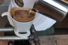 This ensures that the coffee grounds are completely saturated.