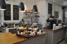 The counter is a two-part affair, food on the left, coffee on the right, menus on the wall.
