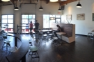 A panoramic view from the back of Heart, standing just in front of the counter, taking in the view from the roaster, on the left, to the entrance-way on the right.