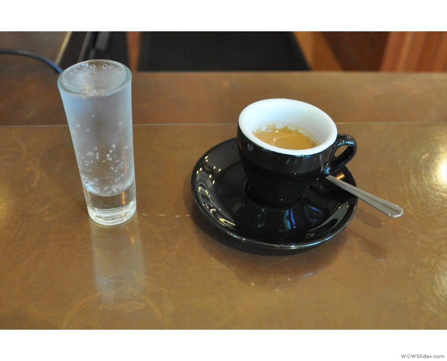This is transfered to a classic black cup for drinking, served with a glass of sparkling water.