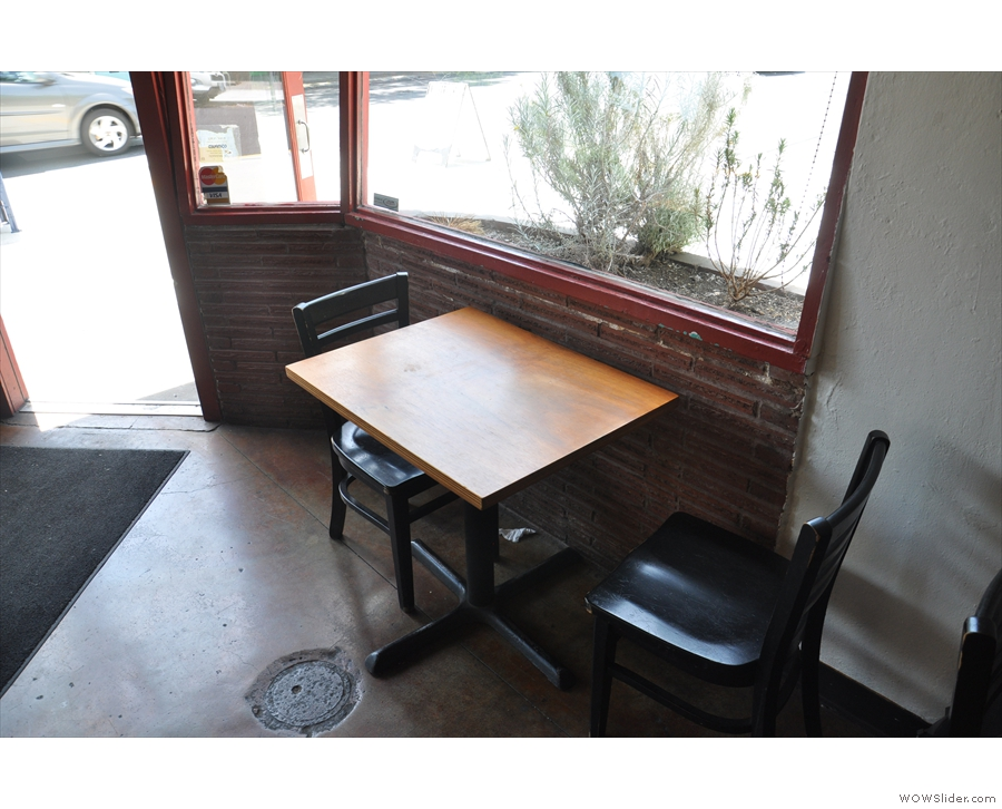 To the left of the door, there's this two-person table...