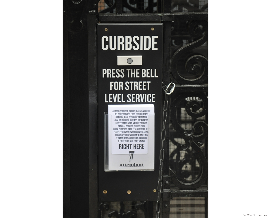 The curbside service bell, next to the benches