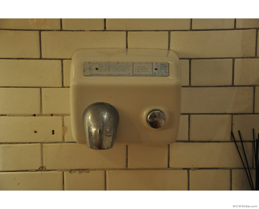 Yes, that is a hand-drier on the wall. Probably not a Victorian original though...