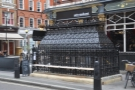Attendant, on Foley Street, outside the Crown & Sceptre. You can see the four fold-down benches on this side.