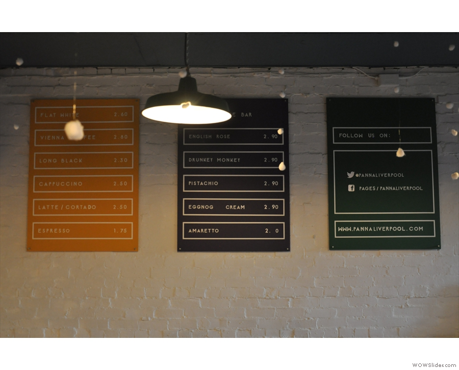 The coffee menus are on the wall to the right of the counter.