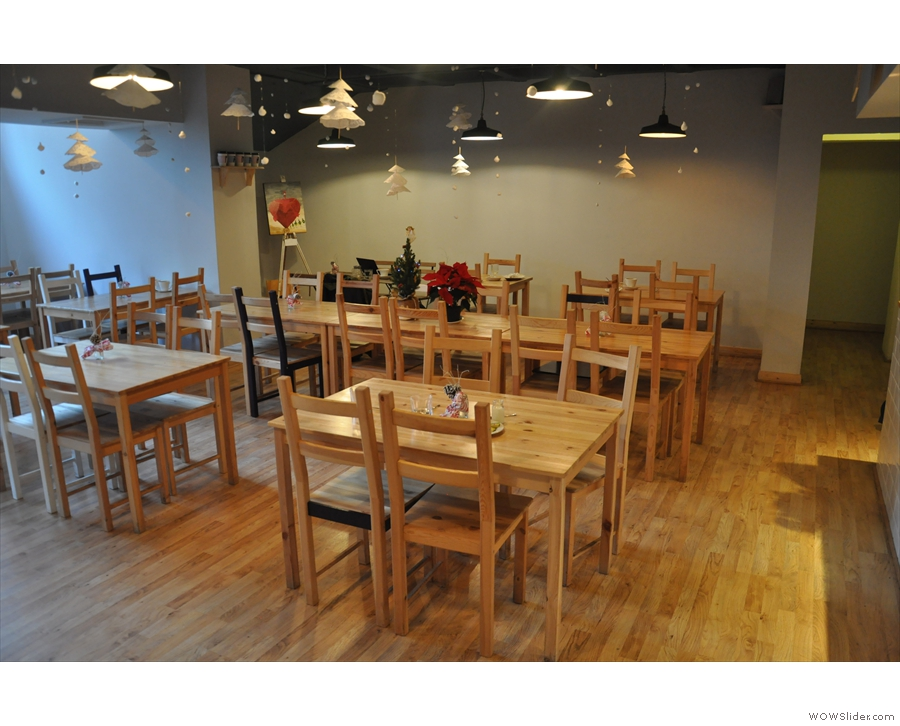 The seating is a simple array of tables and chairs, laid out in rows.